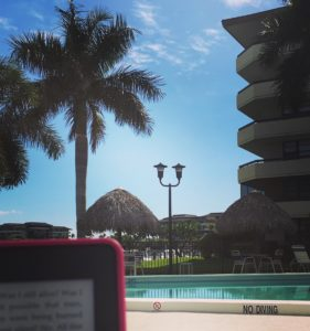 marco-island-reading-by-pool